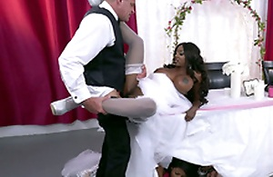 Mature ebony bride Diamond Jackson getting fucked on a table
