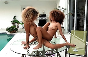 Cecilia Lion and Xianna Hill tribbing pussies on a glass table